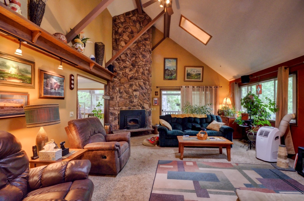 Four Bedroom Living Room with Stone Fireplace