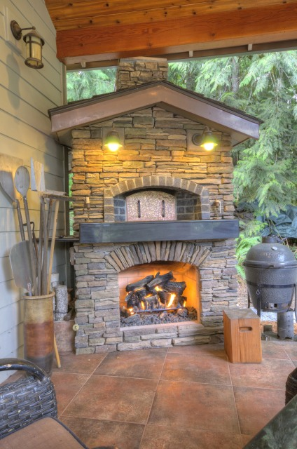 Outdoor Fireplace at this one level Craftsman Home at the Resort at the Mountain